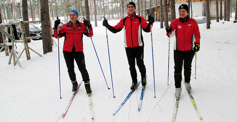 Three Cross-Country Skiers in Red - Volunteers with Bruce Ski Club in Ontario