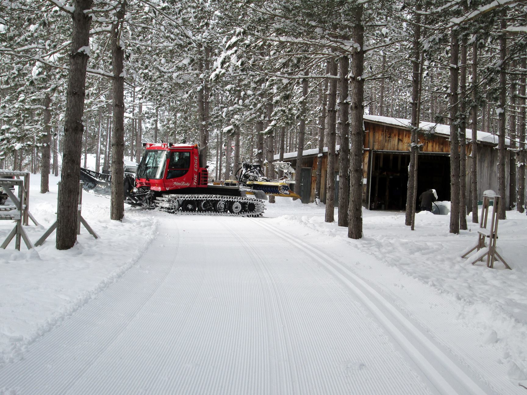 Sawmill Nordic Centre - PistenBully Groomer near ski hut