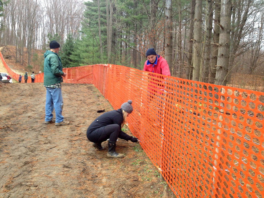 Volunteers repairing snow fence at Sawmill Nordic Centre, Hepworth, Ontario