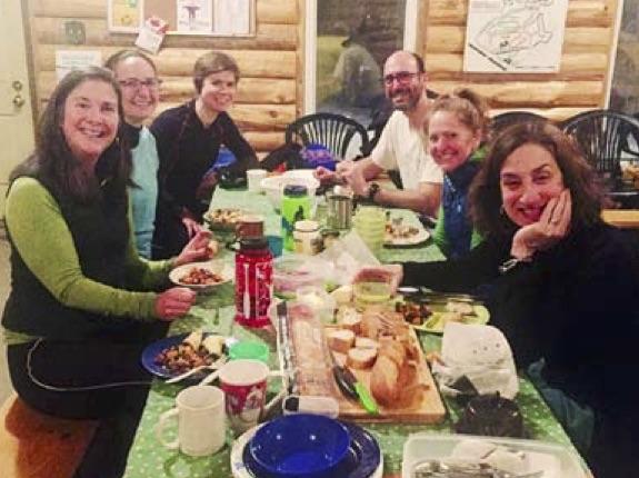 Sawmill Nordic Centre - skiers enjoy hut on Friday night
