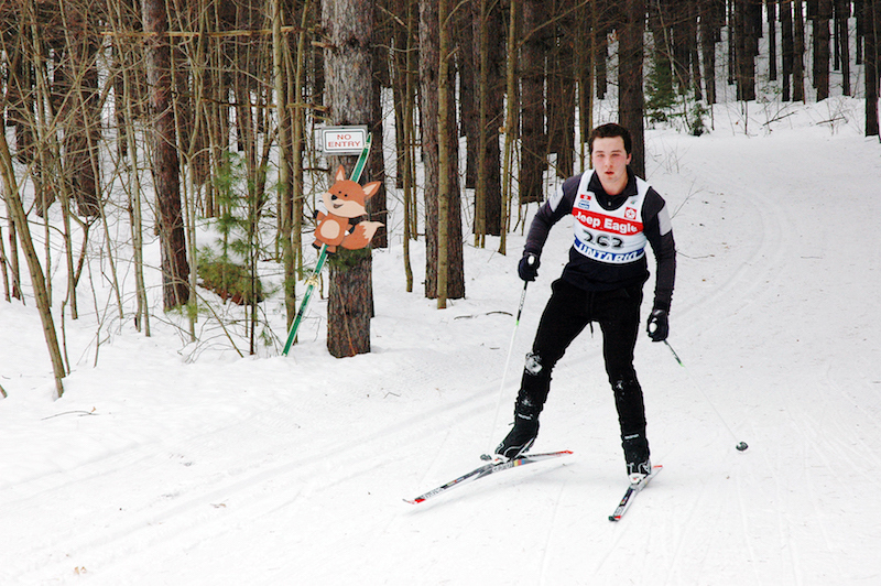 Great Wolf Invitational Cross-Country Ski Race 2017 - skier near fox sign