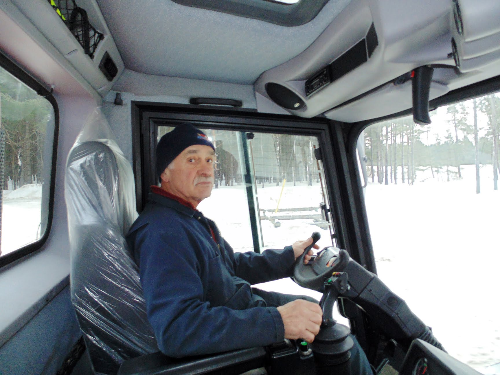 Sawmill Nordic Centre - Fred in cab of PistenBully groomer