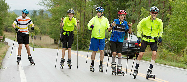 Cross-country skiers practicing on roller skis